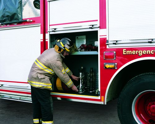 Fireman with roll-up doors on firetruck